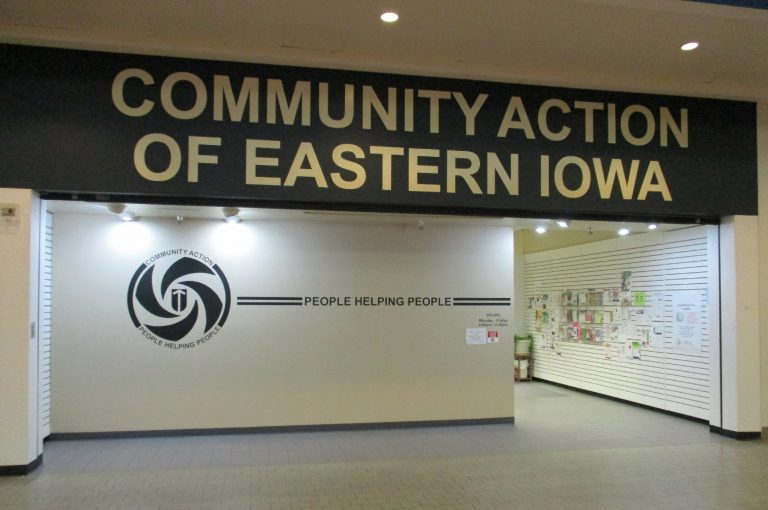 Mall store front with large Community Action sign.