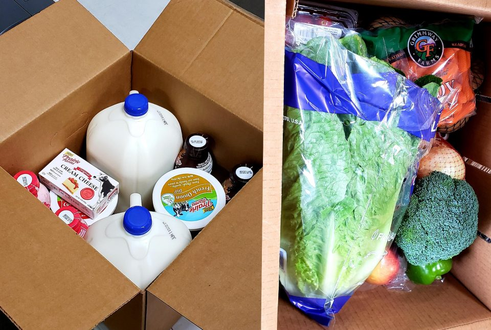 A box of dairy items and a box of vegetables